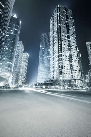 office buildings: futuristic office buildings at night and city road with blue tone in shanghai