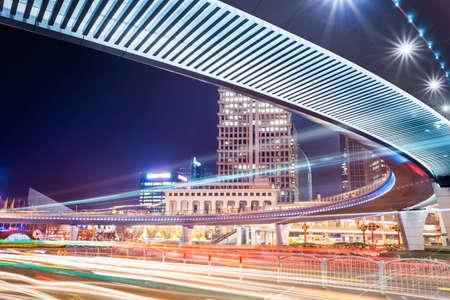 pedestrian bridge: shanghai pedestrian bridge at night with light trails on the downtown