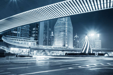 pedestrian bridge: night view of the downtown in shanghai under pedestrian bridge with blue tone