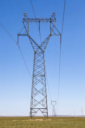 voltage: electric power transmission pylon on inner mongolia grassland ,China Stock Photo