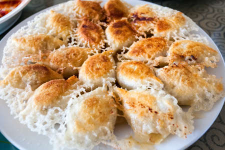 enticing: golden fried dumplings, enticing traditional cuisine closeup Stock Photo