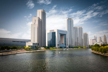 apartment building: tianjin cityscape of beautiful haihe river and modern buildings against a sunny sky Stock Photo