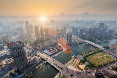 sunset city: modern city in sunset, aerial view of tianjin cityscape