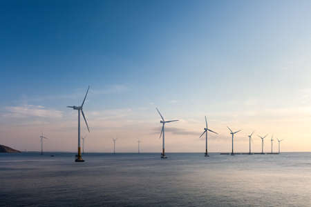 offshore wind farm at dusk, renewable energy background Imagens - 70055414