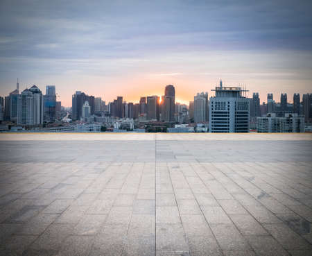 city road: empty brick floor with cityscape and skyline, tianjin in sunset Stock Photo
