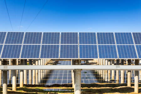 electric power: solar power plant against the sunny sky, renewable energy closeup