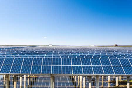 cerulean: solar energy in prairie under the sunny sky, clean energy background