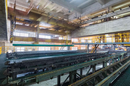 industrial production workshop closeup in a lead and zinc metal factory, automatic peeling zinc production line Editorial