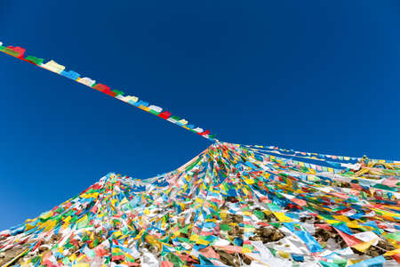the wind-horse flags on tibetan snow mountain,the symbol of harmony among heaven,earth,human beings and animals