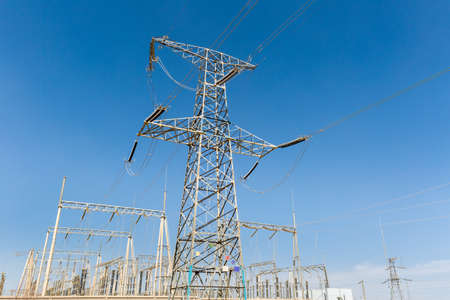 transformer substation against a blue sky, electric power concept Stock Photo