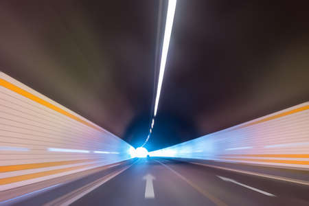 abstract speed motion in highway tunnel, blurred motion toward the central