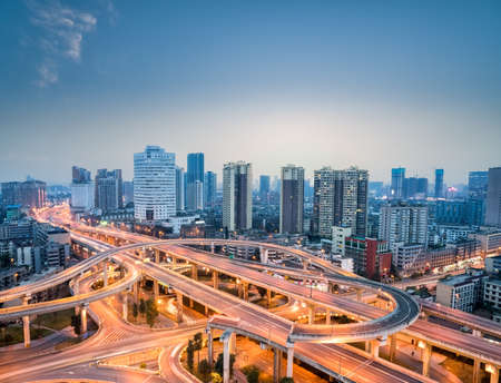 city interchange in nightfall, chengdu skyline with overpass background Stock Photo