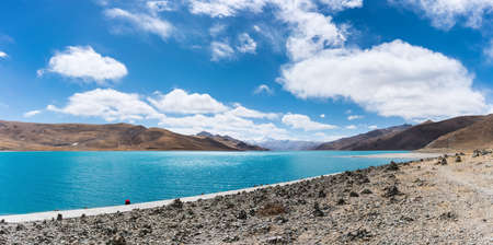 landscape with holy lake, mountain and pile of stone in  China. Banco de Imagens