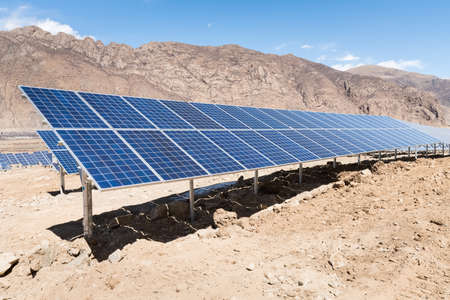 green power: photovoltaic power station , closeup of solar energy panels with sunny sky