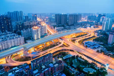 wuhan city interchange in nightfall, cityscape with traffic infrastructure background, China