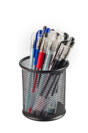 metal grid: various gel pens in metal grid container isolated on white with clipping path Stock Photo