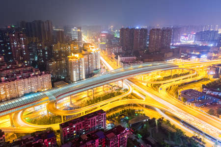 aerial view of city interchange overpass at night , wuhan, China