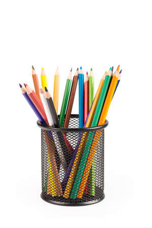 color pencils in metal grid container isolated on white with clipping path Stock Photo
