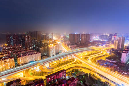 aerial view of wuhan overpass at night, city interchange of traffic development, China
