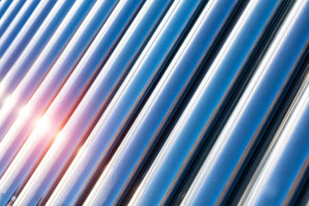 solar water heater closeup , sunlight on blue vacuum tubes