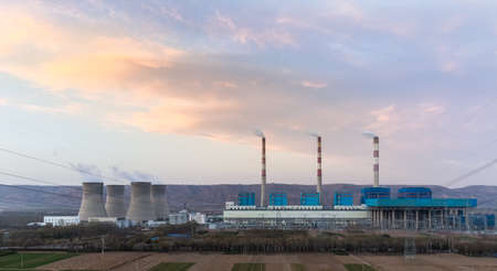 thermal power plant on loess plateau at dusk , China