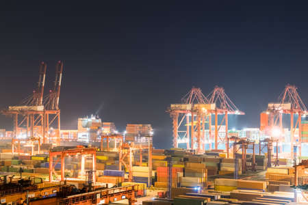 shipping container terminal at night, busy modern harbor in shanghai