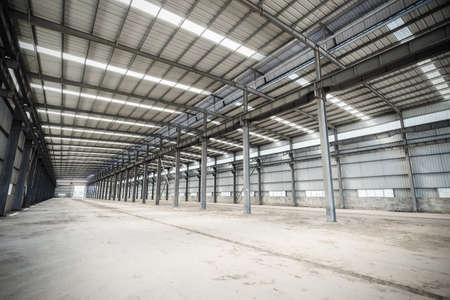 metal structure: empty steel structure workshop, abandoned factory buildings or warehouse  background