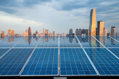 city twilight reflected on the solar energy panels