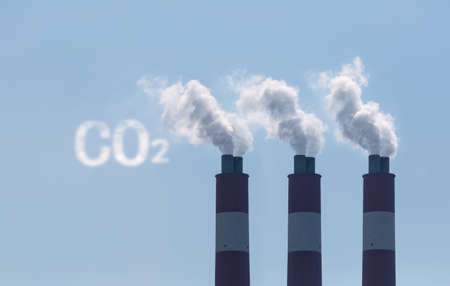 factory chimneys with symbolic emission of a CO2 cloud