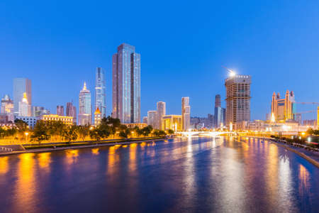 tianjin cityscape of night scene, beautiful haihe river with modern buildings