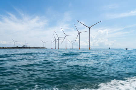 offshore wind farm with beautiful seascape , indonesia 免版税图像