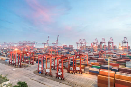 shanghai container terminal in sunset, modern international logistics and trade background Stok Fotoğraf
