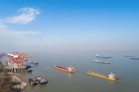 inland container terminal with yangtze river landscape, water transpor background