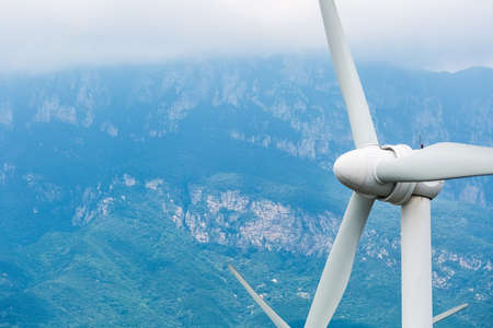 renewable energy closeup, wind power generation with cliff background Stock Photo