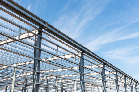 steel structure workshop background with blue sky Stock Photo