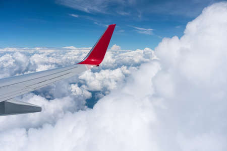 airfoil above the clouds, taking an airplane trip