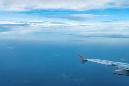 airplane wing view in the air, travel by plane Stock Photo