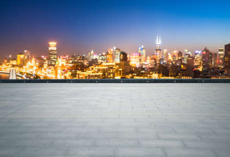 empty brick floor with dreamlike cityscape and skyline, shanghai the bund at night Stock Photo
