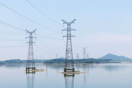 power transmission tower closeup on the lake