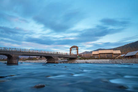 hemu villages at dusk, slow shutter shooting of bridge and river ,a famous tourist destination in xinjiang