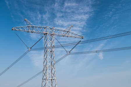 Transmission tower under blue sky