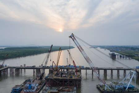 bridge construction site on yangtze river at dusk