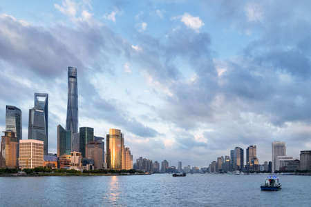 modern buildings on both sides of the huangpu river, shanghai cityscape at dusk