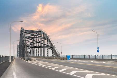 steel bridge and road with sunset sky, jiujiang city ,China