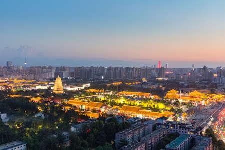 beautiful nightfall view of xian, famous big wild goose pagoda with city skyline, China