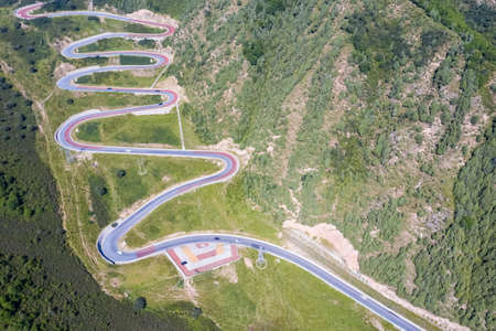 aerial view of winding mountain road, qinghai north mountain forest park, China