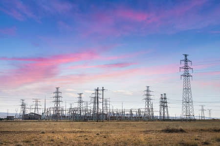 electric substation on the prairie with sunset glow Banco de Imagens