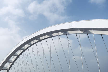 close-up of partial arched girder of suspension bridge