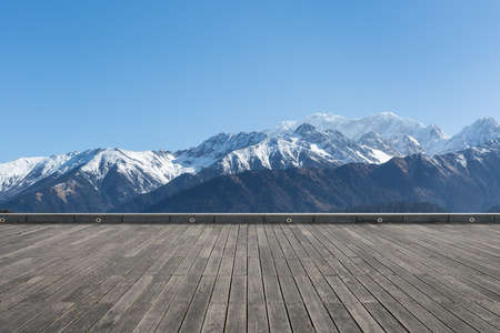 beautiful natural scenery, snow mountain background with wooden floor foreground, tibetan plateau landscape, China
