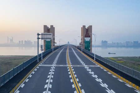 jiujiang yangtze river bridge  in early morning ,bridge tower and pavements closeup